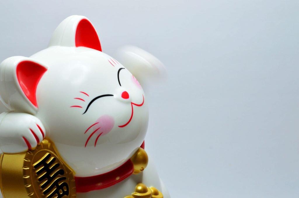cat figurine smiling