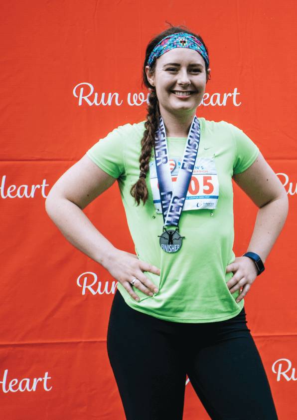 woman with a race medal