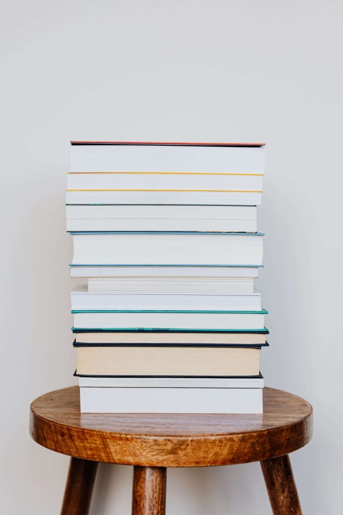 a stack of books on a stool