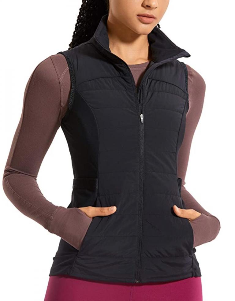 girl modeling black vest