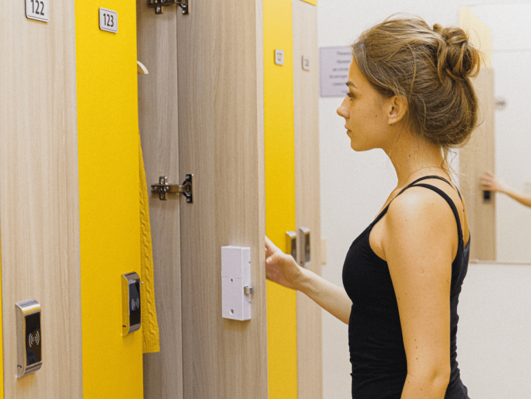 girl opening locker